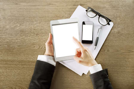 hands touching on tablet in a office Stock Photo - 17421415
