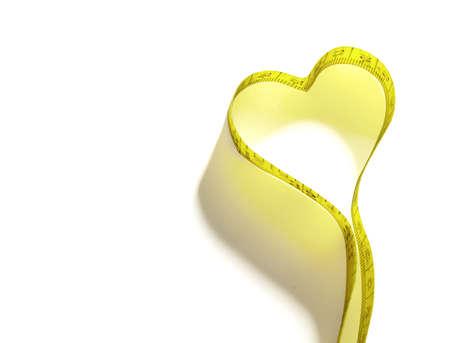 cintas: Cinta m?trica amarilla aislada en el fondo blanco Foto de archivo