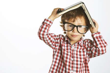 rimmed: Retrato de un chico con gafas de montura aislados en blanco Foto de archivo