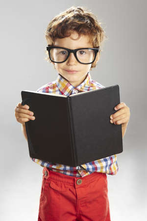rimmed: Portrait of child with rimmed glasses isolated on grey background