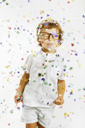 Portrait of a happy child wrapped with confetti photo