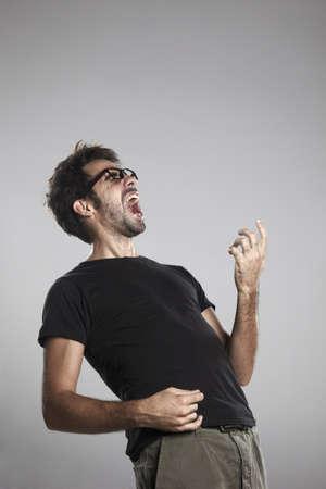 Expressive boy on a grey background Stock Photo - 17668544