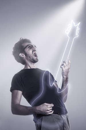 Expressive boy on a grey background