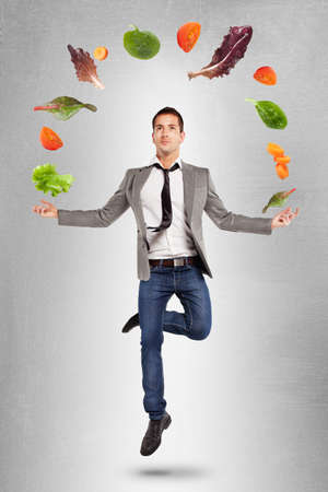 levitation: Yoga businessman on grey background Stock Photo