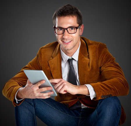 rimmed: Portrait of attractive businessman with rimmed glasses on grey background Stock Photo