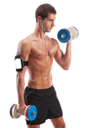 pectorals: Causasian man with weights listening portable music