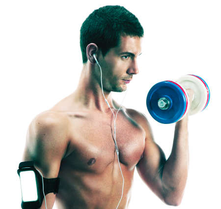 causasian: Causasian man with weights listening portable music