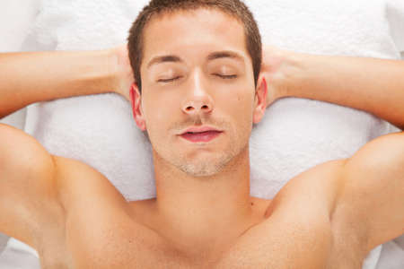 male massage: Handsome man relaxed in spa