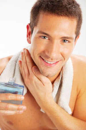shave: Portrait of a young handsome man with a skin for shaving Stock Photo