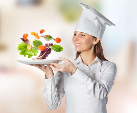 Chef serving empty plate with vegetables in suspension photo