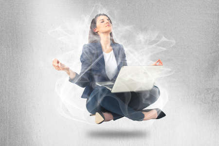Beautiful business woman meditating and making yoga Stock Photo - 18523991