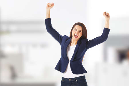 Caucasian businesswoman cheerful for her succes at the office