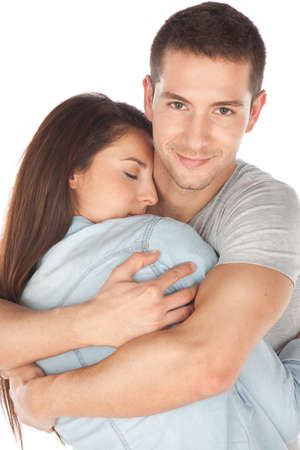 young couple smiling: Romantic young couple embracing Stock Photo