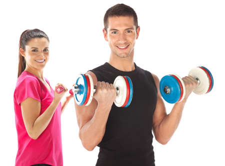 Young man and woman lifting weights  Isolated on white photo