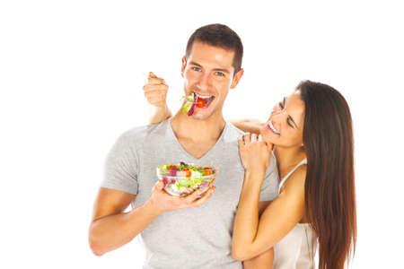 familia comiendo: Pareja joven degustar una ensalada