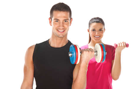 couple exercising: Young couple exercising with weights together