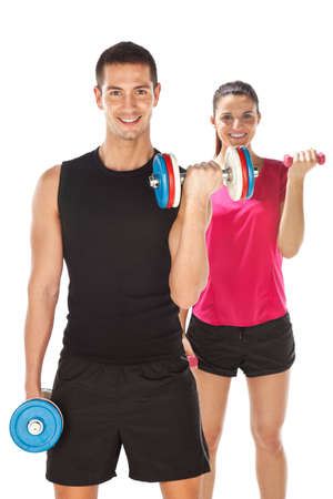 Young couple exercising with weights together photo