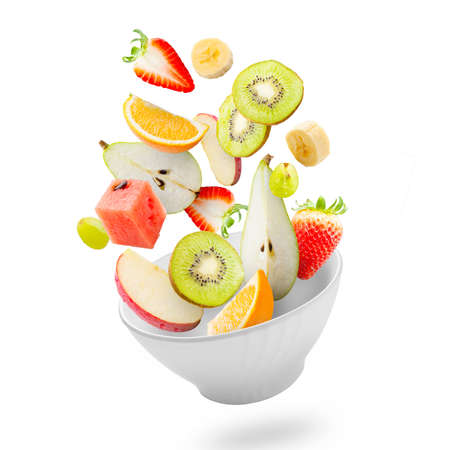 breakfast food: Assorted fresh fruits flying in a bowl Stock Photo