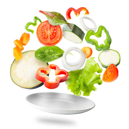 Light salad with flying fresh vegetables photo