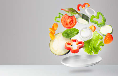 Light salad with flying fresh vegetables