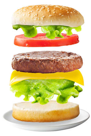 flying float: Big hamburger with fresh ingredients  Stock Photo