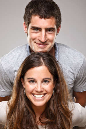 toothy smile: Close up of a young smiling couple Stock Photo