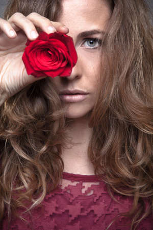 Portraito of young woman with rose photo