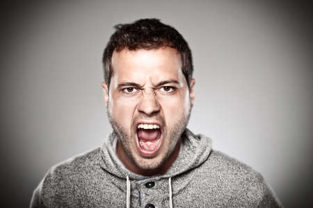 angry face: Portrait of a normal man looking furious  Stock Photo