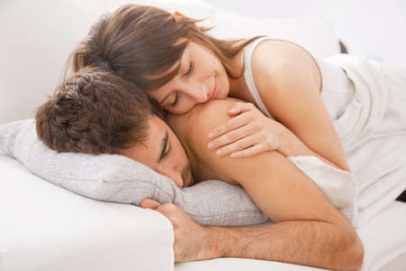 lovely couple: Lovely couple resting in bedroom Stock Photo