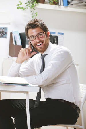 rimmed: Businessman with rimmed glasses working.