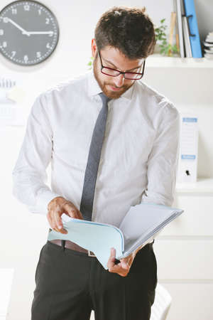 Businessman with rimmed glasses working. photo