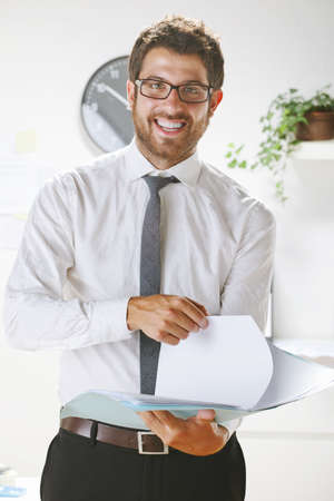 rimmed: Businessman with rimmed glasses looking at camera.