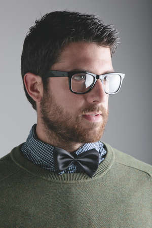 Young modern man portrait wearing bow tie. photo
