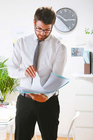 rimmed: Businessman with rimmed glasses working  Stock Photo