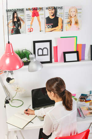 Young creative woman on a laptop in her office  photo