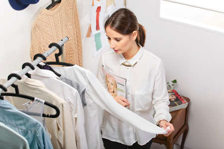 personal shopper: Fashion woman with magazine working in her office