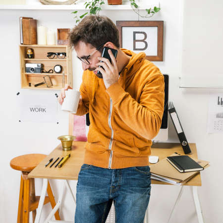 creative entrepreneur on the phone in The office photo