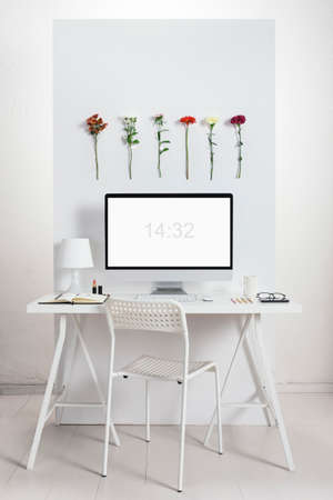 White creative office with flowers environment  Stock Photo