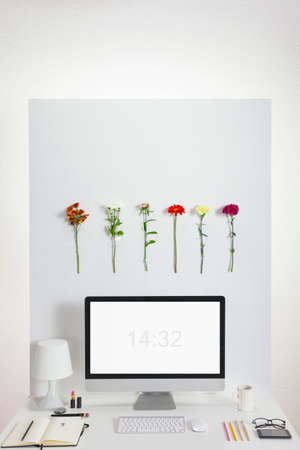 office environment: White creative office with flowers environment  Stock Photo
