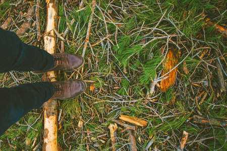 treading: Overhead of man boots treading a pine log