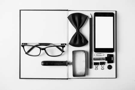 Overhead of essentials office objects in black and white  photo