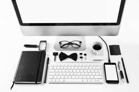 Overhead of essentials office objects in black and white