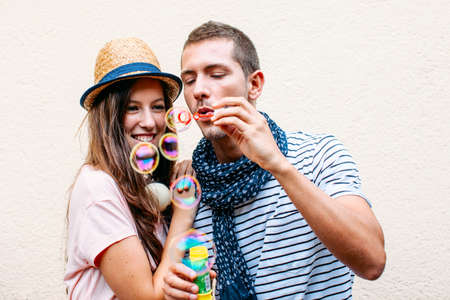 blowing bubbles: Funny lovely couple  Stock Photo