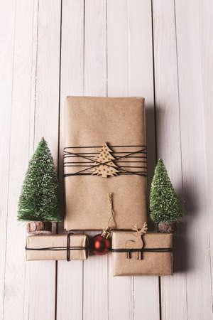 Three small presents with Xmas decoration. photo