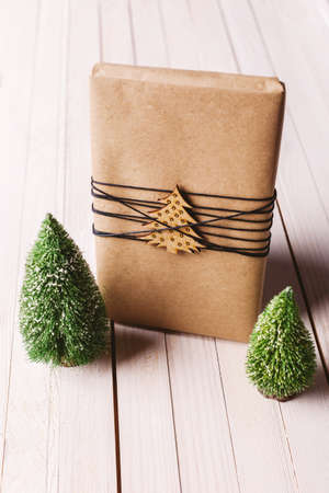 wrapped gift: Beautiful present with Xmas decoration. Stock Photo
