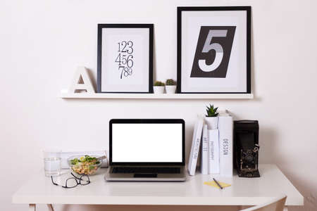 business desk: Black and white office at home.