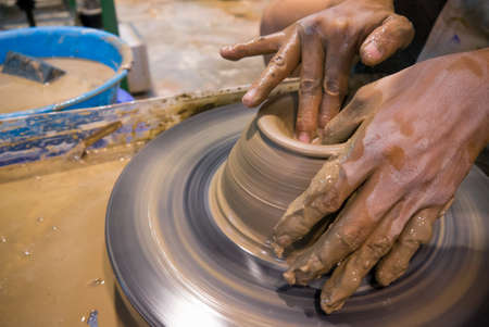 potter: asian clay potter on a potter wheel