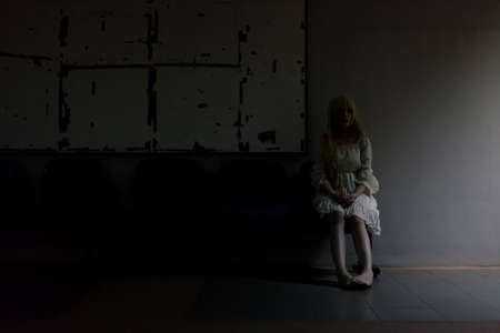 portrait of asian girl in white dress ready for halloween night,  low key picture Stock fotó