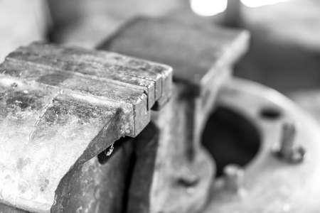 fix jaw: Custom bench vise install on old wheel rim Stock Photo