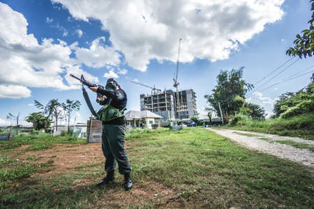 aiming: Thai air soft gun player in combat suit Stock Photo